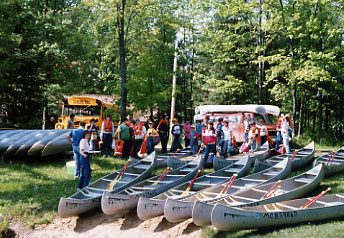 Youth group camping and canoeing on the Muskegon River with White Birch